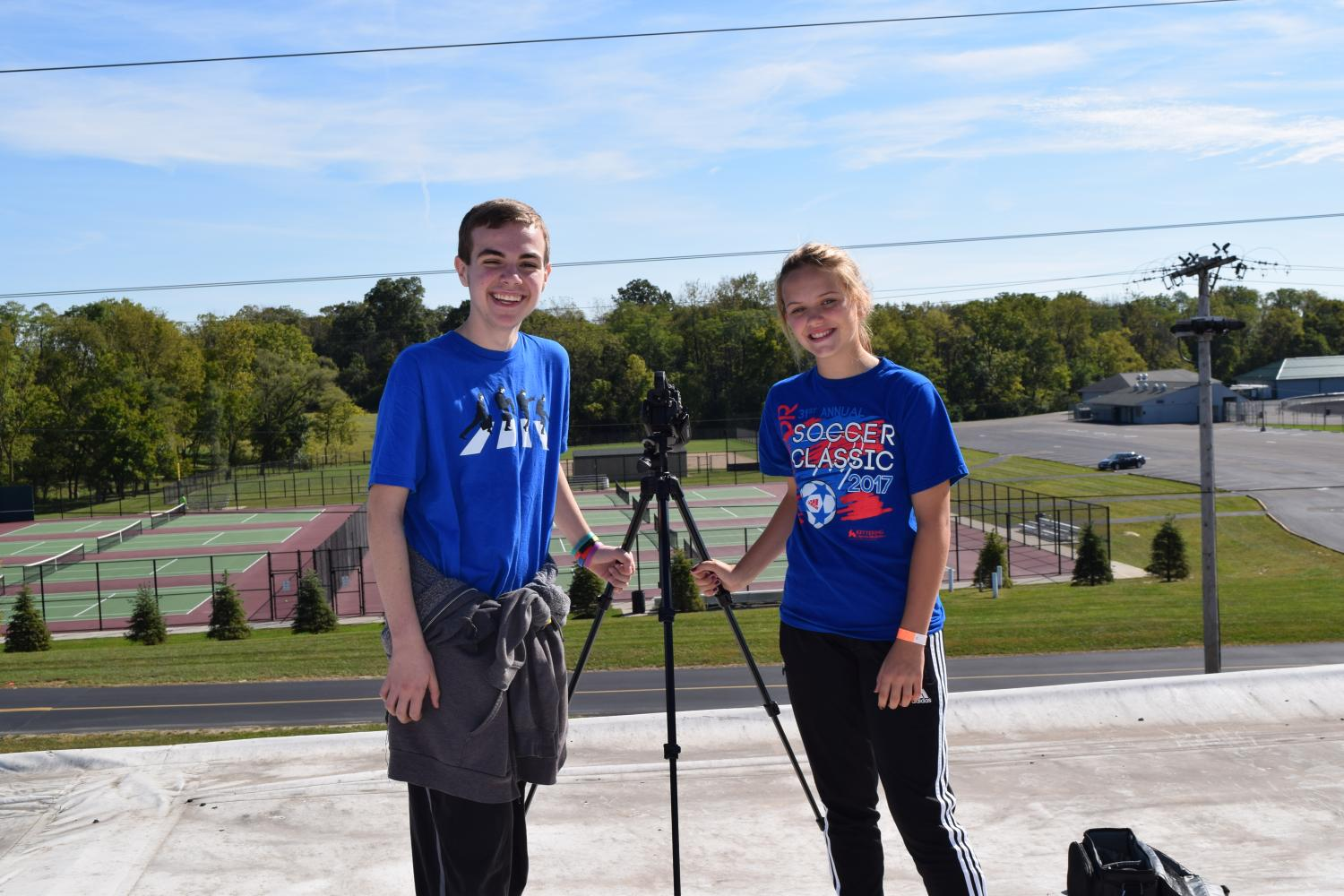 Andrew Marcum and Danielle Coomer pose on the roof of the middle school.